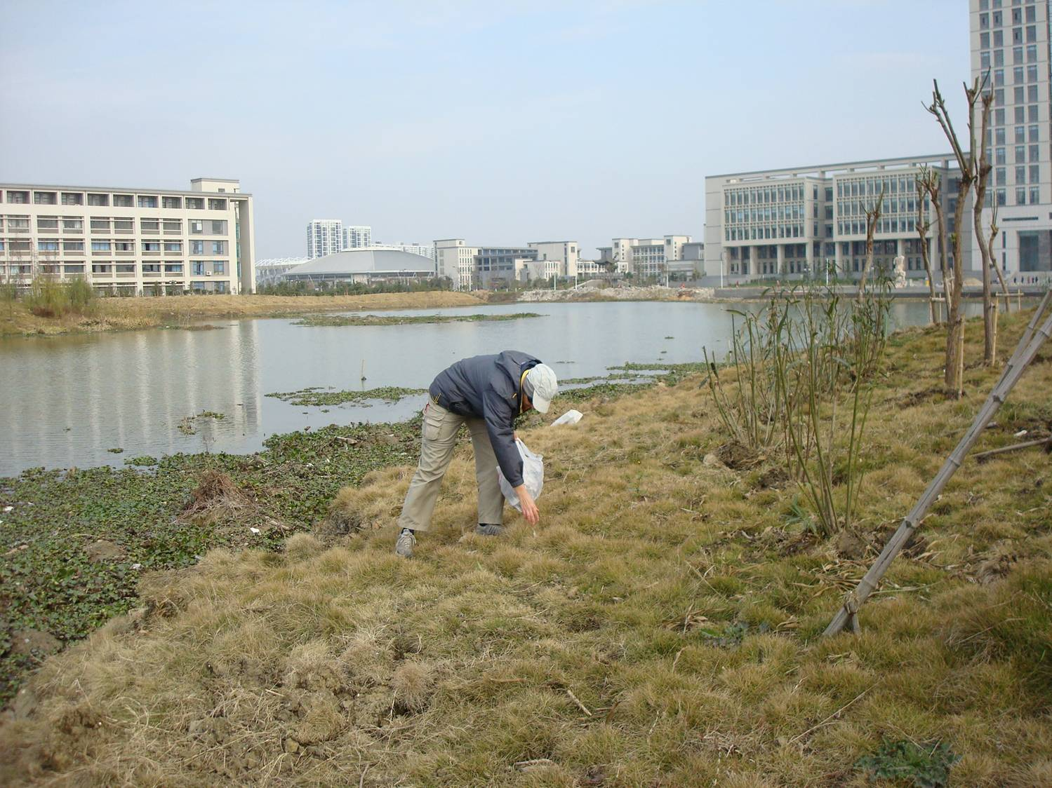 Ruth Anderson picks up litter Jiangnan University,  Wuxi,  China
