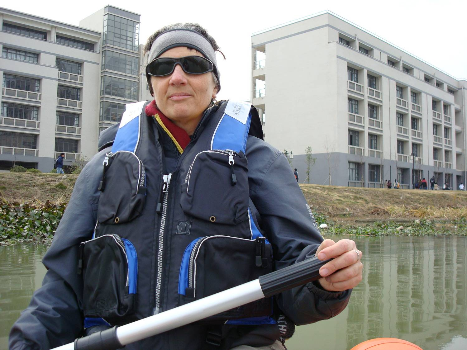 Ruth Anderson paddles dingy Jiangnan University,  Wuxi,  China