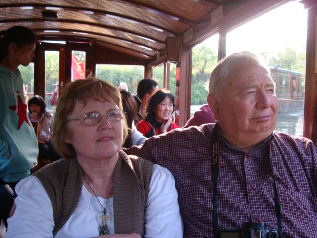 Jim and Janet enjoy the boatride through the wetlands.  Hangzhou, China