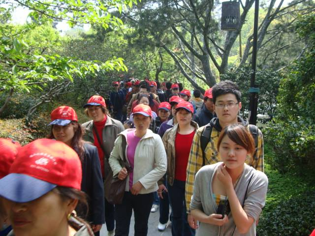 The trails around West Lake were jammed with tour groups in identical hats.  Hangzhou, China
