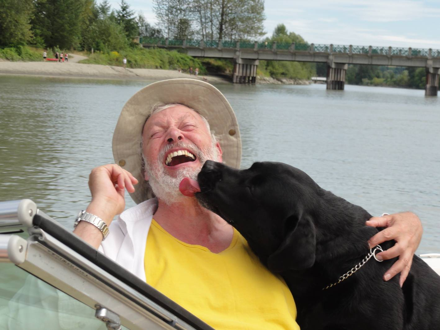 Picture:  Axel the boat dog gives me a kiss on the Fraser River between Mission and Maple Ridbge, B.C., Canada