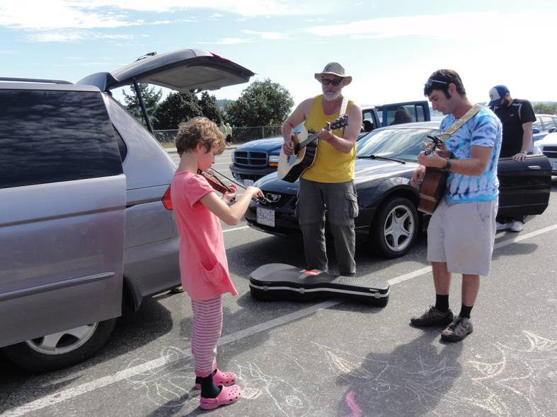 Picture:  an impromptu jam session with a talented young violinist while we wait for the ferry.