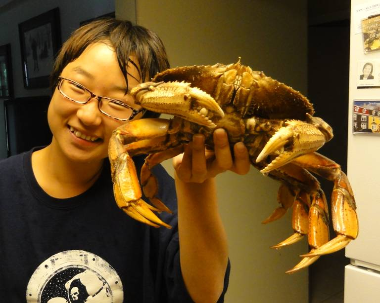 Picture:  Panda with one of the crabs that my friend Don gave us during our visit to Gibsons Landing.