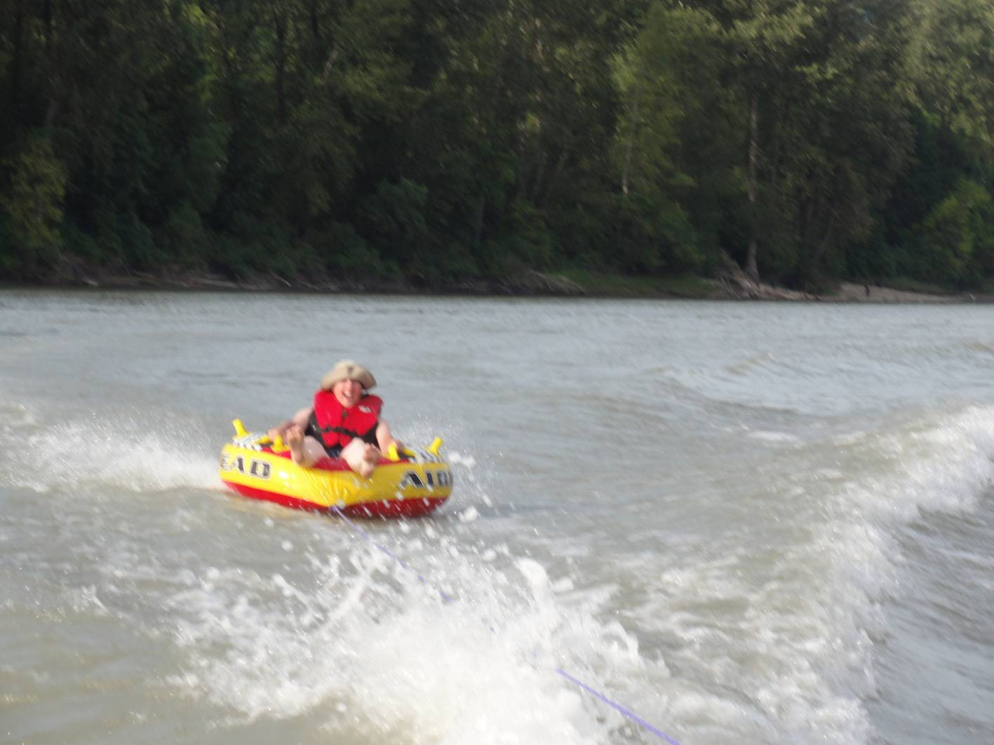 Picture:  Ruth went for a drag on the tube behind the boat.  The Fraser River, B.C., Canada