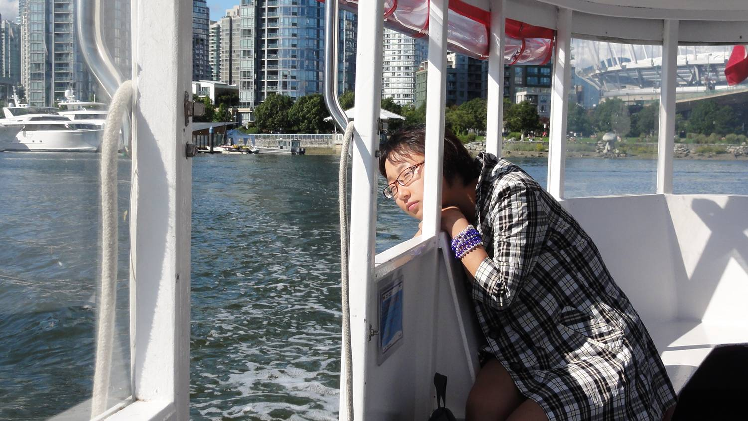 Picture:  The Chinese visitor checks out the seal from the little False Creek ferry.  Vancouver, B.C.