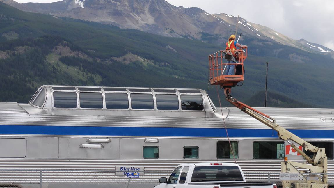 Picture:  Workers wash the train windows in preparation for the mountain views.  Via Rail, Canada