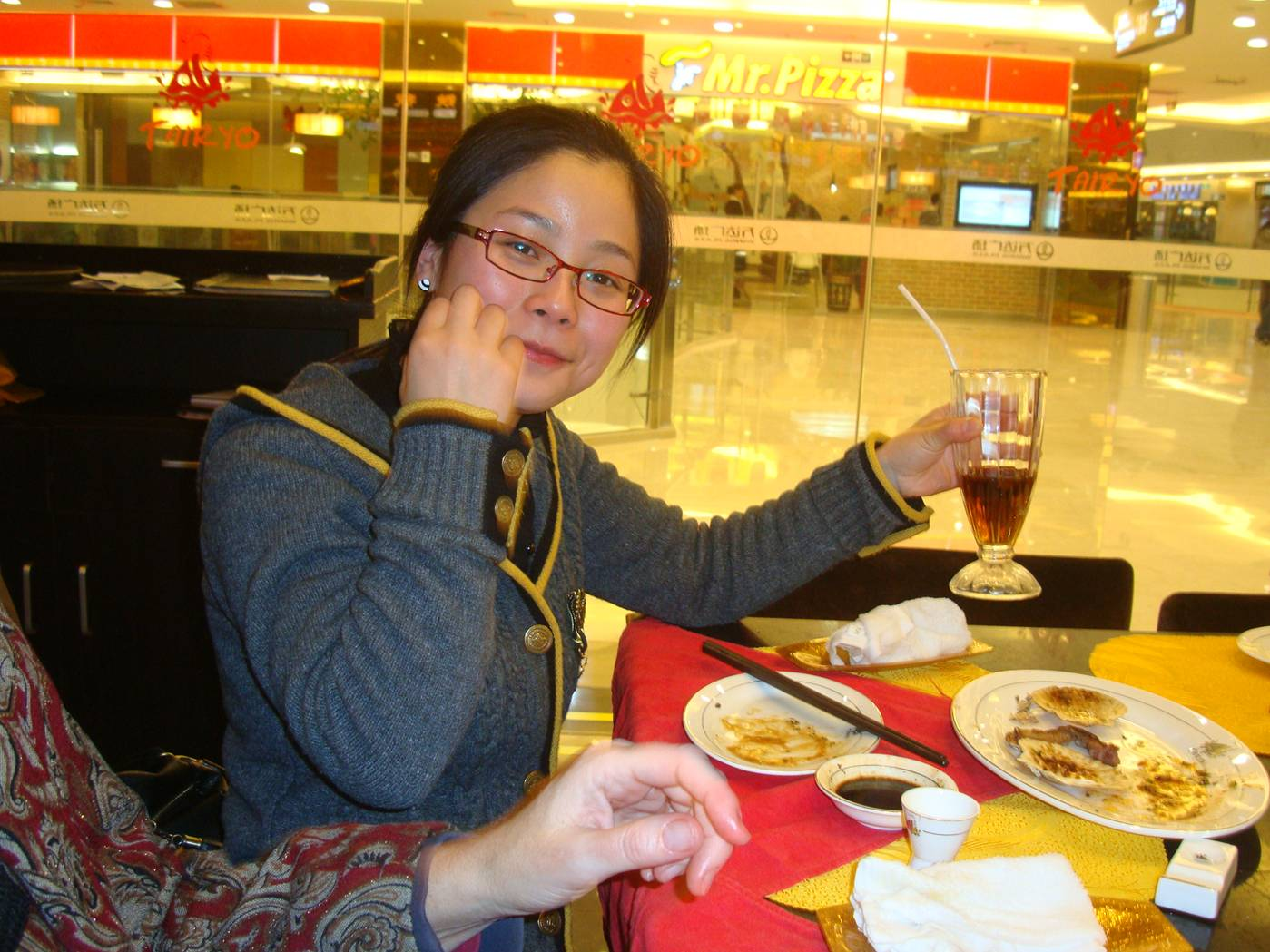 Picture:  Our Chinese teacher, Carolyn, having a conversion experience.  She found out she likes Japanese food.  Wuxi, China