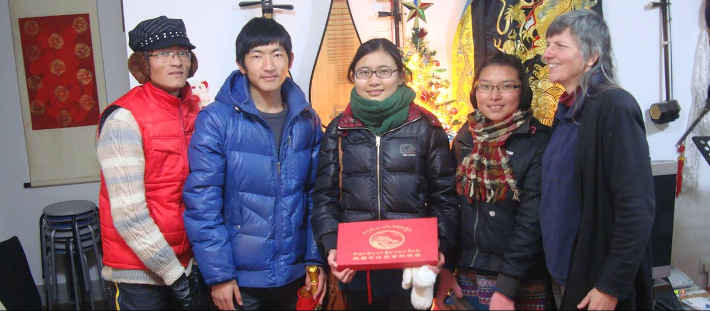 Picture:  Our Tibetan English Club members showed up with some exquisite presents.  Thanks you guys, you shouldn't have.  Really.  Jiangnan University, Wuxi, China