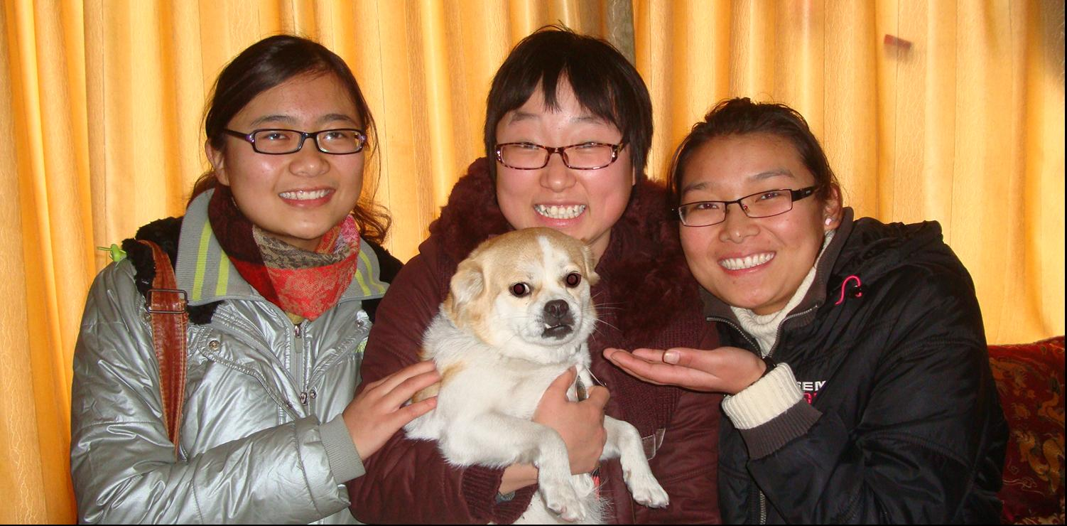 Picture:  Panda, holding GouGou,  flanked by our Tibetan dog sitters.  Jiangnan University, Wuxi, China
