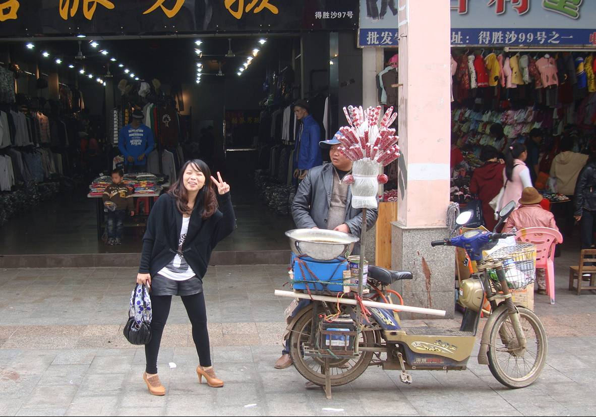 Picture:  The girl just likes to get her picture taken.  Haikou on Hainan Island, China