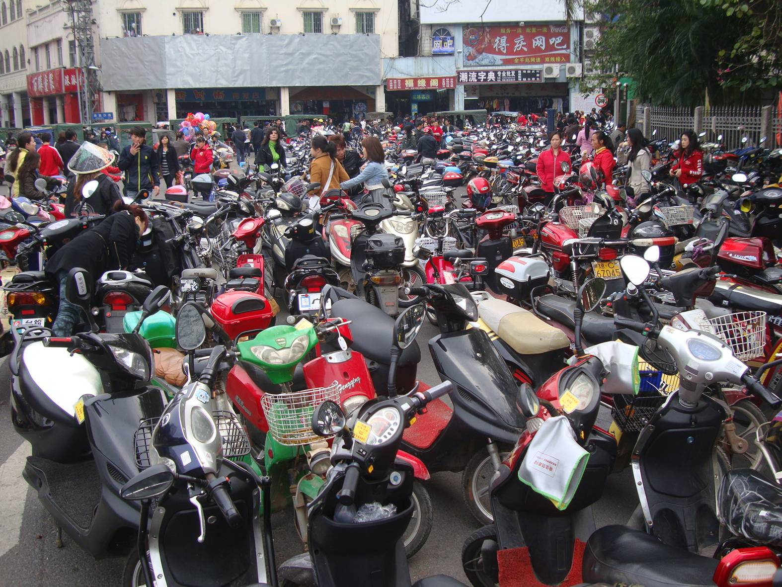 Picture: The e-bike parking lot outside the market street.  Haikou on Hainan Island.  China