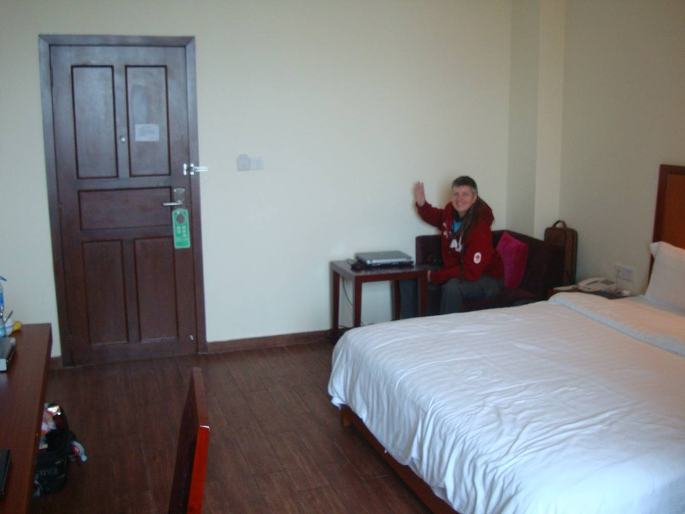 Picture:  Ruth waves from her station at the laptop in our hotel room.  Haikou on Hainan Island, China