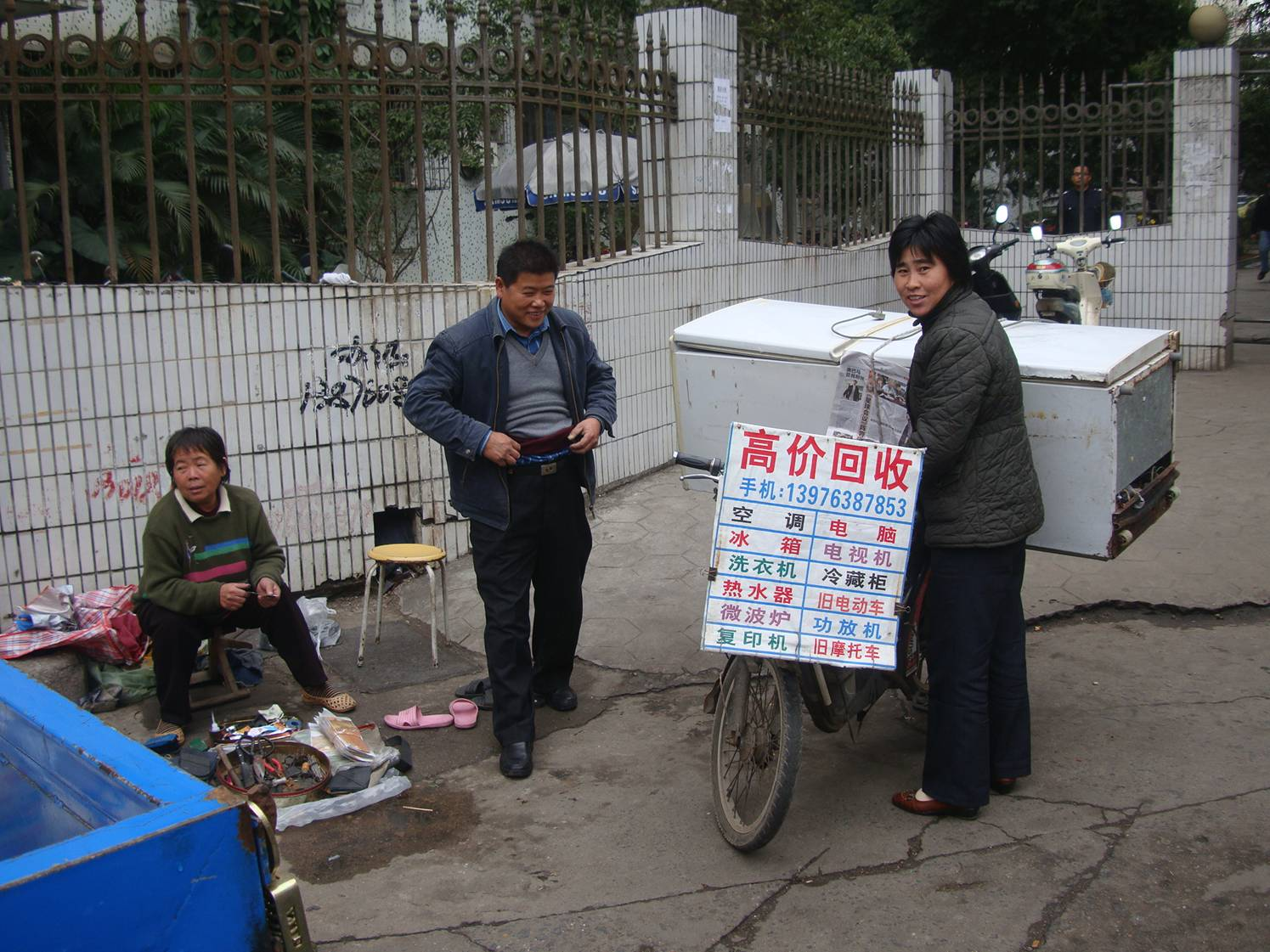 Picture:  Moving the refrigerator on the bicycle.  Haikou, China.