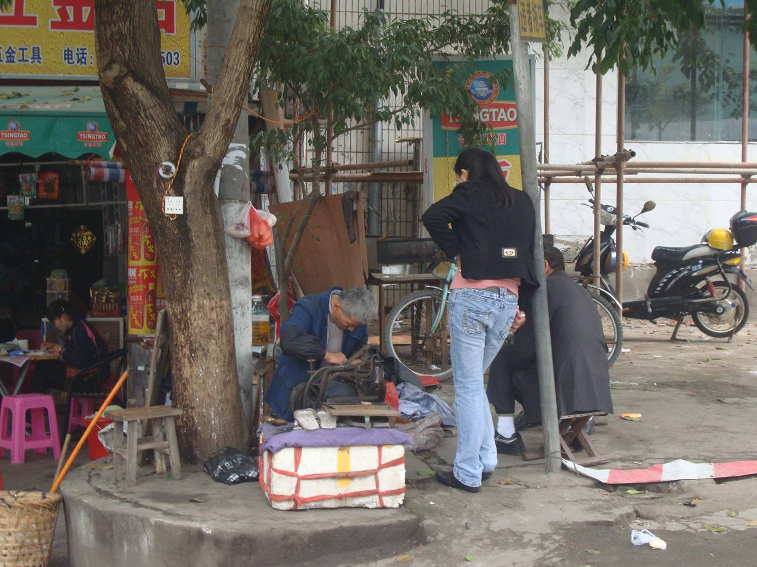 Picture:  Bike repair on the streets of Haikou, Hainan Island, China.