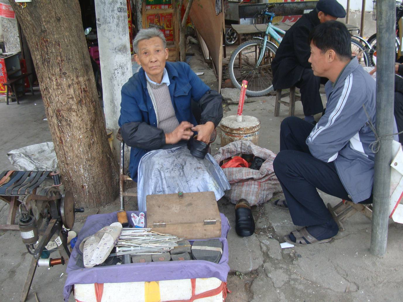 Picture:  Shoe repair and shoe shines on the streets of Haikou, Hainan Island, China
