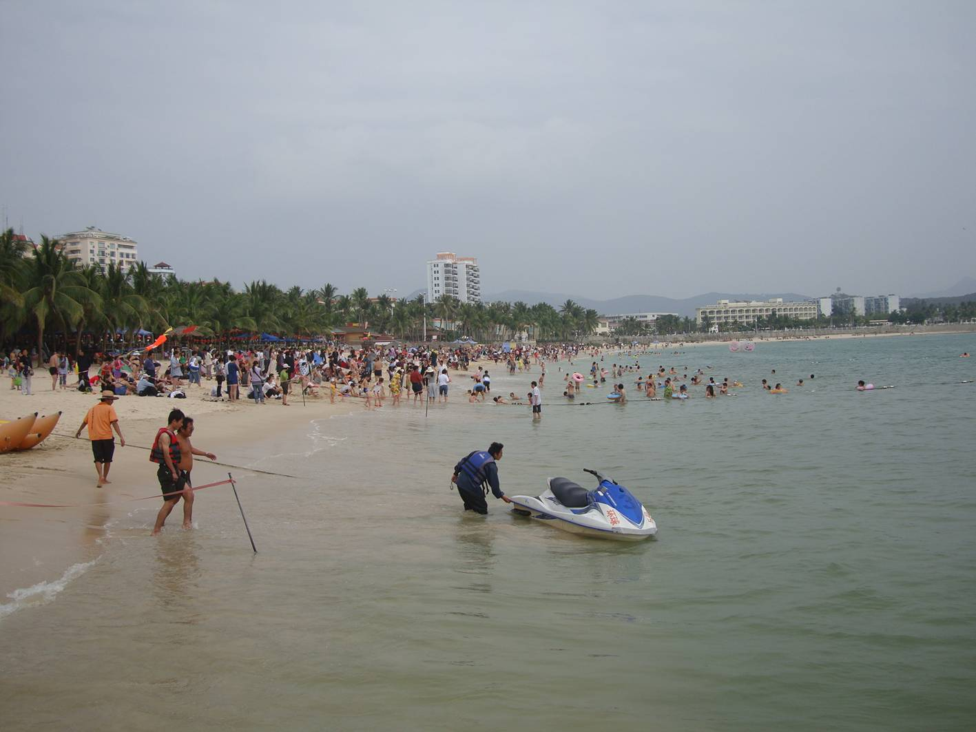 Picture:  The beach at Da Dong Hai, Hainan Island, China.  Fun and games.