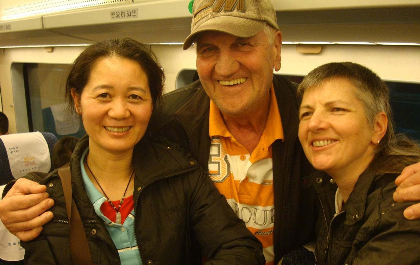 Picture:  Friendly travelling companions on the train from Sanya back to Haikou.  Hainan Island, China