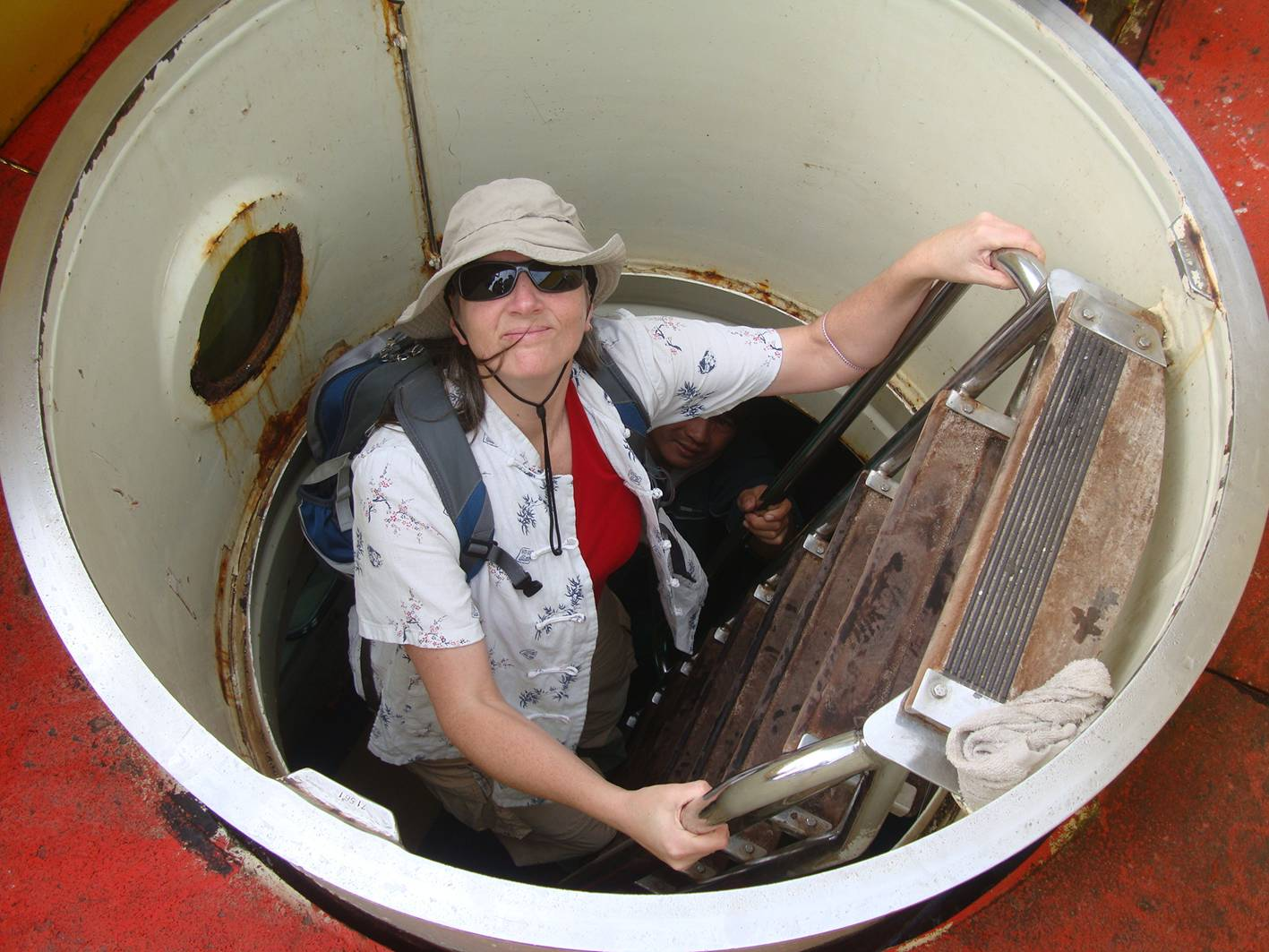 Picture:  Down the hatch.  Ruth  boards the submarine for an undersea tour of Sanya bay.  Hainan Island, China