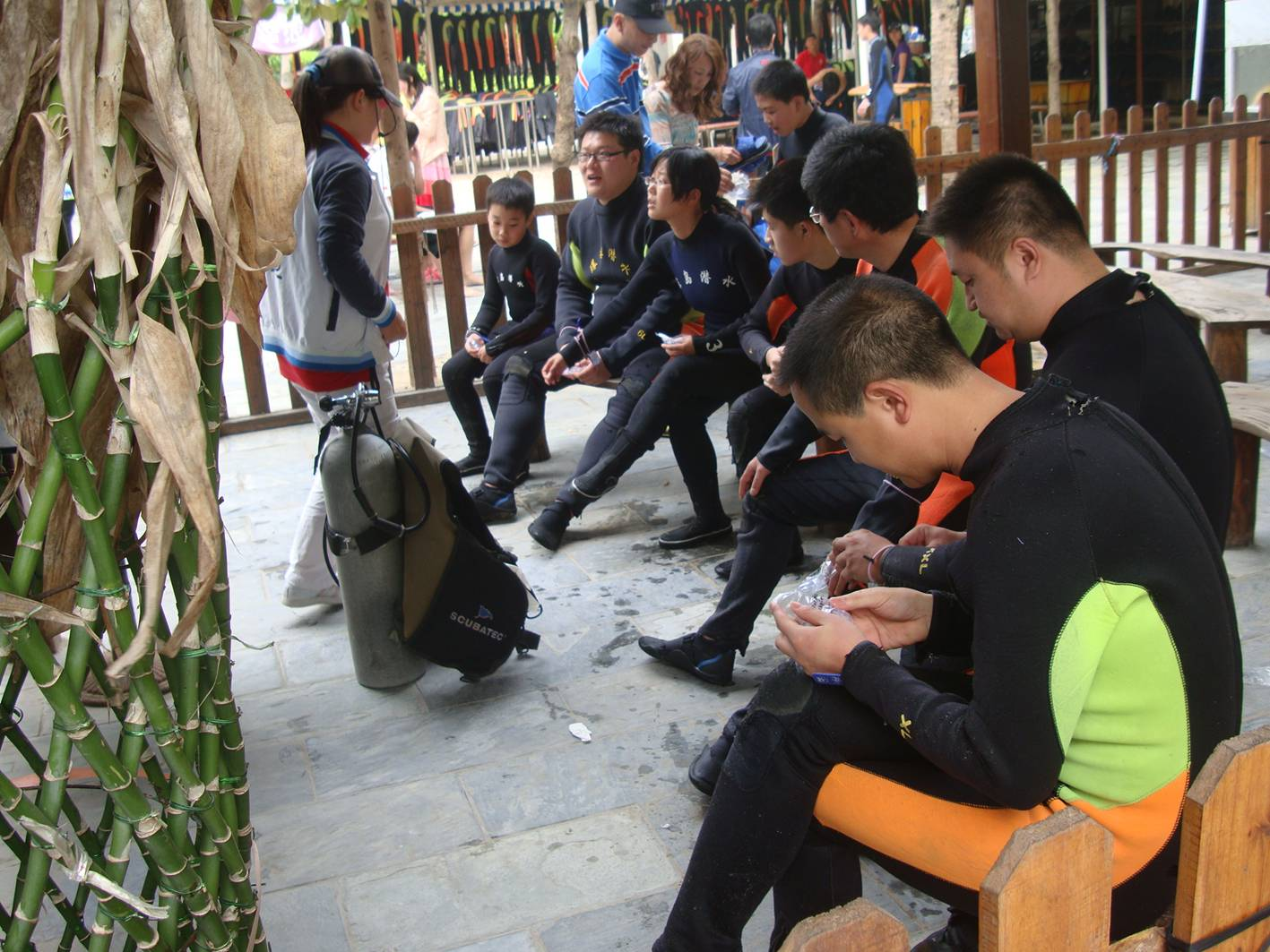 Picture:  Tourists dressed for scuba dragging await their ten minutes of training.  Da Dong Hai, Hainan Island, China