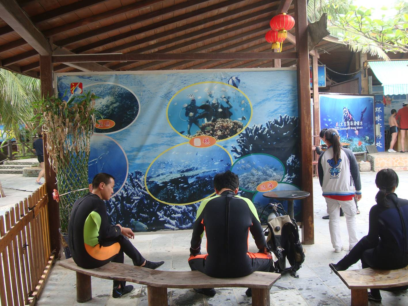 Picture;  Tourists dressed for scuba dragging.  Da Dong Hai, Hainan Island, China