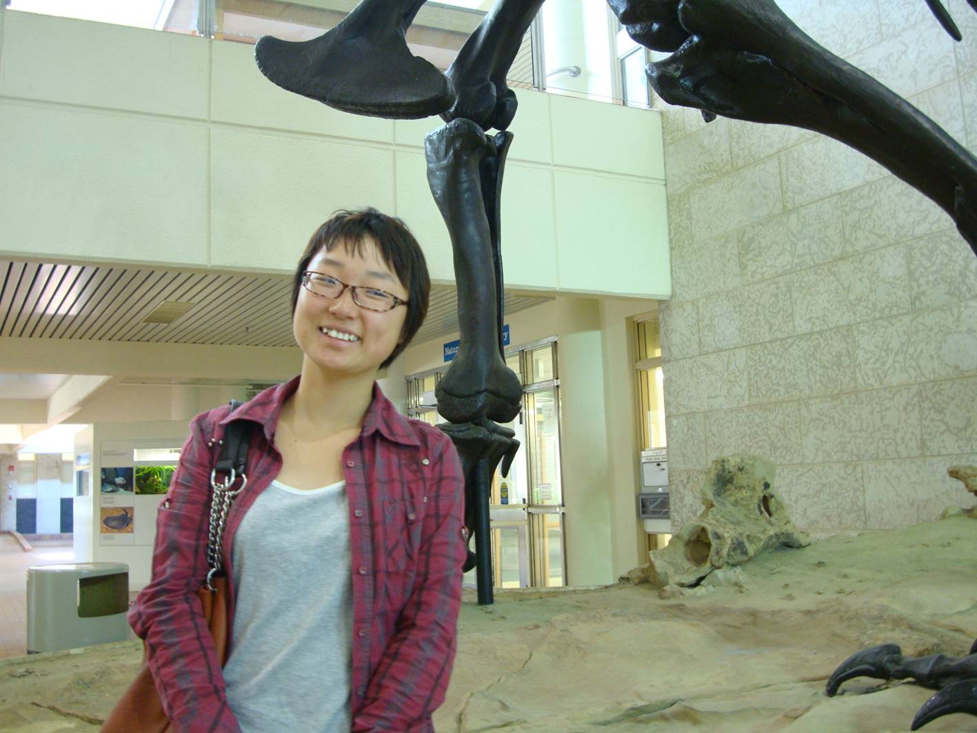 Picture: Panda beneath the T-rex. Touring the University of Saskatchewan Geology department.
