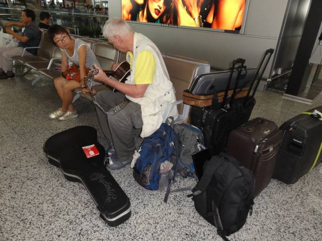 Picture:  Guitar practice in the Shanghai airport.  China