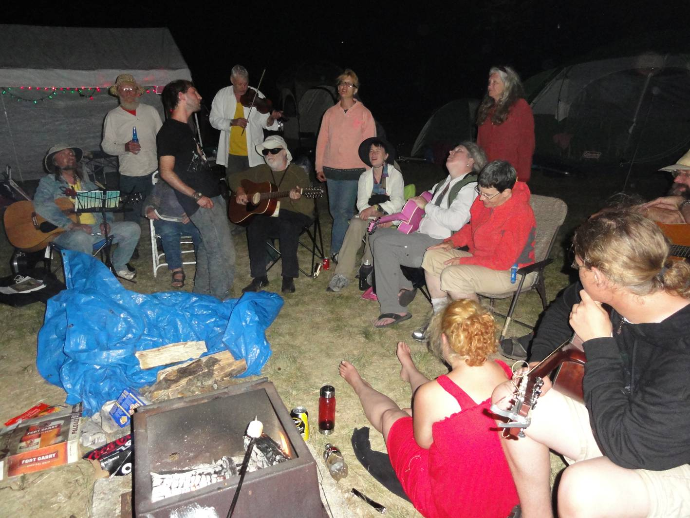 Picture:  the Baggiecon music circle on the final night of camping at the Winnipeg Folk Festival.