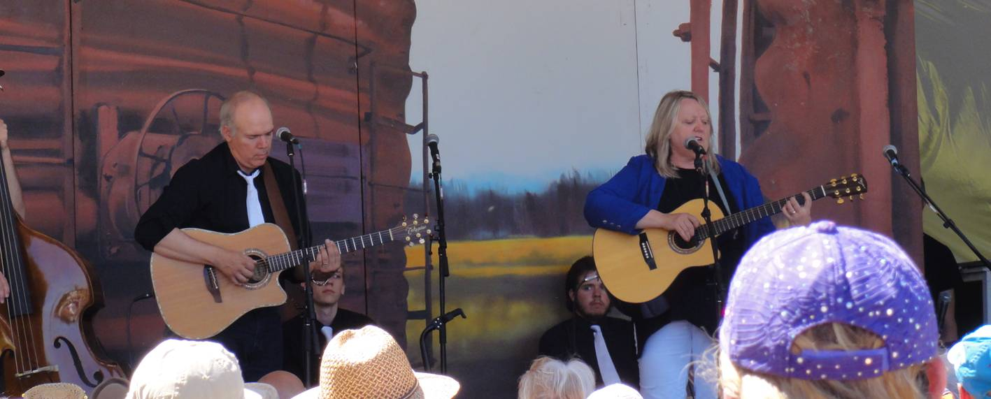 "Connie Kaldor in concert with her ""record producer and co-producer of my backup band"" husband.  Winnipeg Folk Festival."