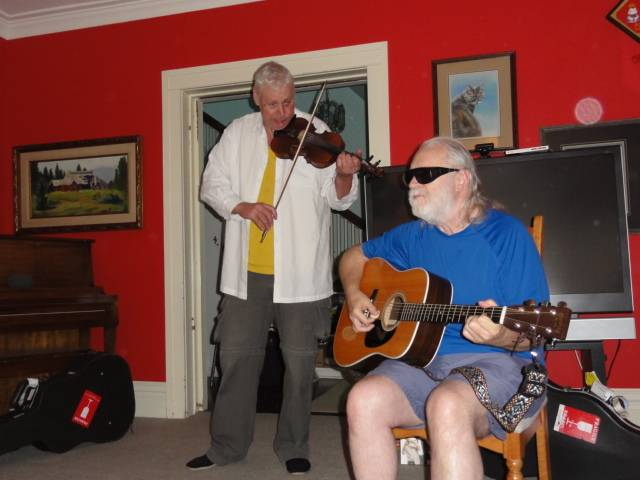 Picture:  Dave sings.  I try to add tasteful fiddle licks, sometimes successfully.
