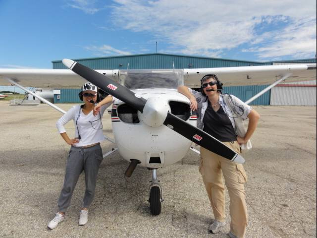 Picture:  Panda and Ruth pose with the plane.  Winnipeg.
