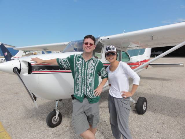 Picture:  Panda and her pilot.  What a generous offer, a free sight seeing flight over the Manitoba countryside.