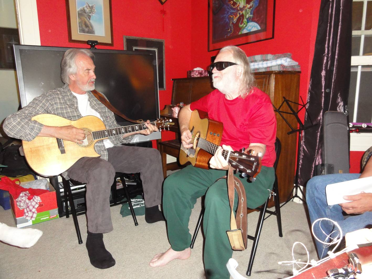 Picture:  Fred Penner and Dave Clement contribute to the music circle at the Dead Mouse Party, Winnipeg