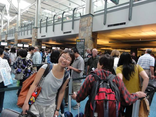 Picture:  Fatigue and a huge lineup at customs could not dampen the mood.  Panda approaches immigration in the Vancouver airport.