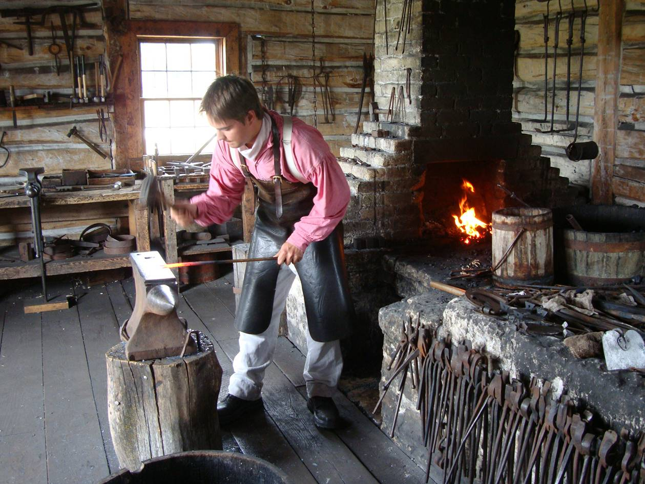 Picture:  The blacksmith at Lower Fort Garry in his recreated shop.  Winnipeg, Manitoba, Canada
