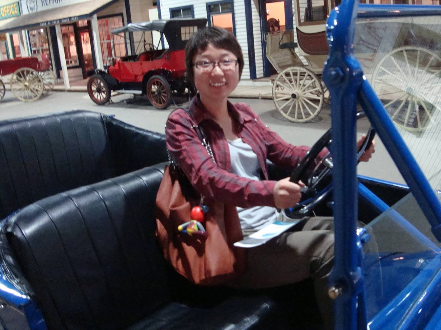 Picture:  Panda at the wheel of an antique car in Boomtown within the Western Development Museum in Saskatoon.