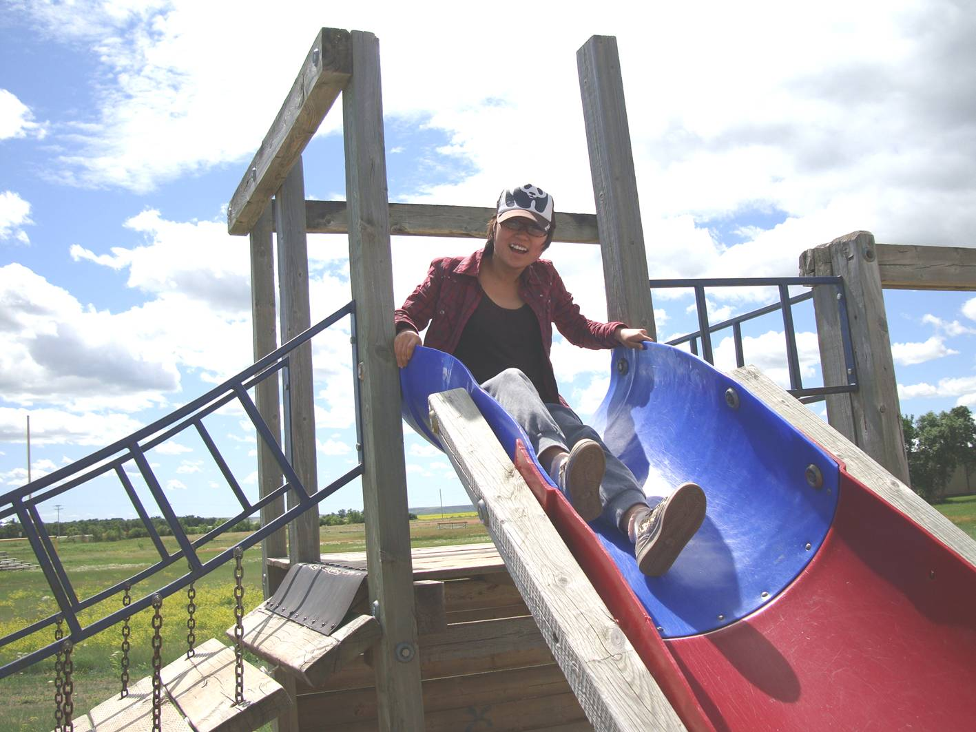 Picture:  Panda enjoys a slide on the playground equipment Ruth helped build twenty-seven years ago.  Elrose, Saskatchewan