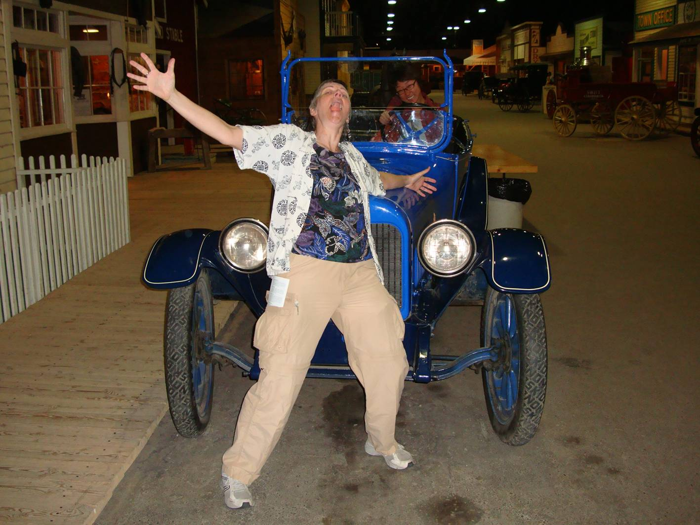 Picture:  Ruth hams it up in front of an antique car with Panda at the wheel.  Saskatoon, Saskatchewan, Canada