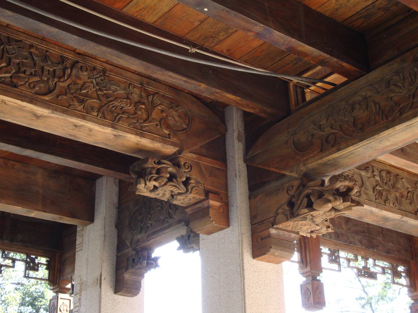 Picture:  Above her head, this elaborate classical post and beam ceiling.  Wuxi old city, Wuxi, China