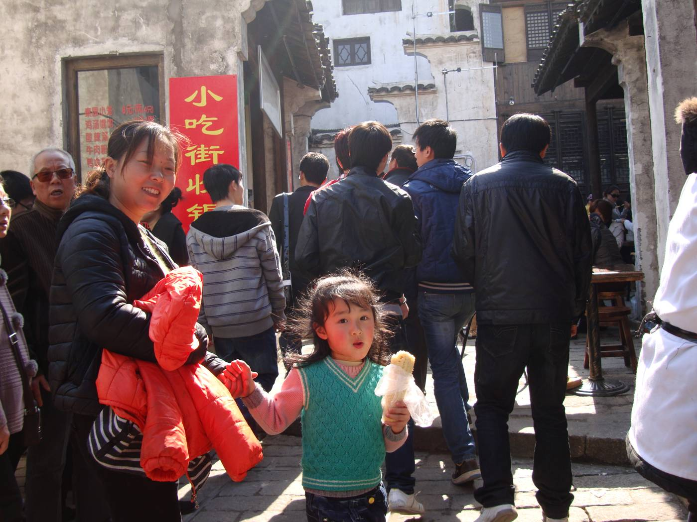 Picture:  For some kids, a foreigner is still something to comment on.  Wuxi ancient city, Wuxi, China