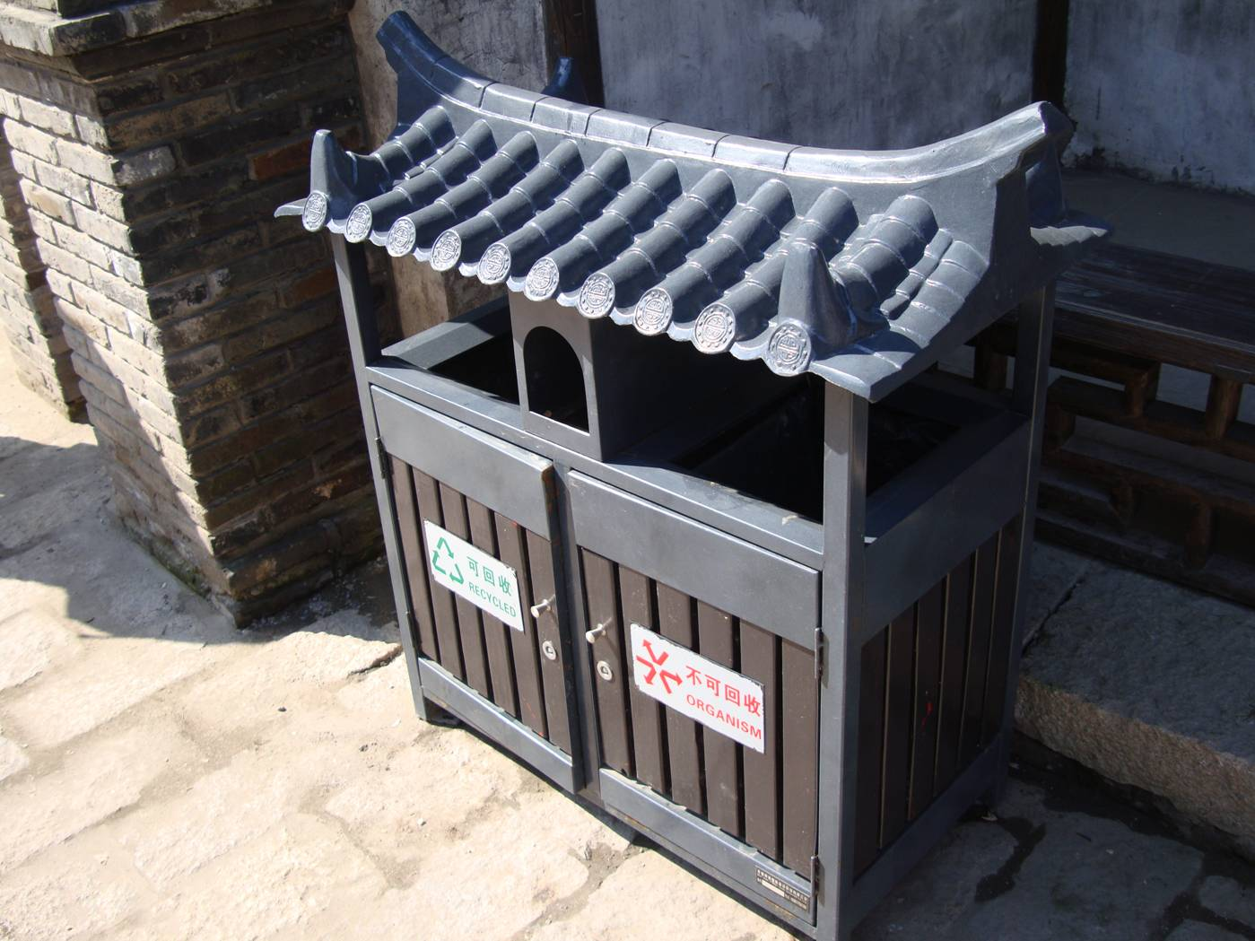 Picture:  The ancient theme is carried into the garbage receptacles, with questionable stylistic success.  Wuxi old city, Wuxi, China