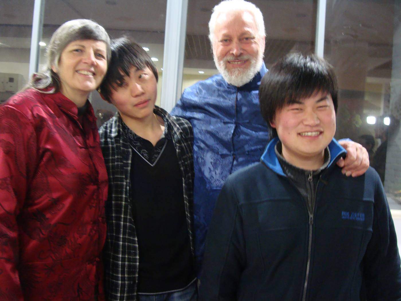 Picture:  Ruth and David with Hucher and Jack, makers and shakers of Chun Hui Young Volunteers.  Jiangnan University, Wuxi, China