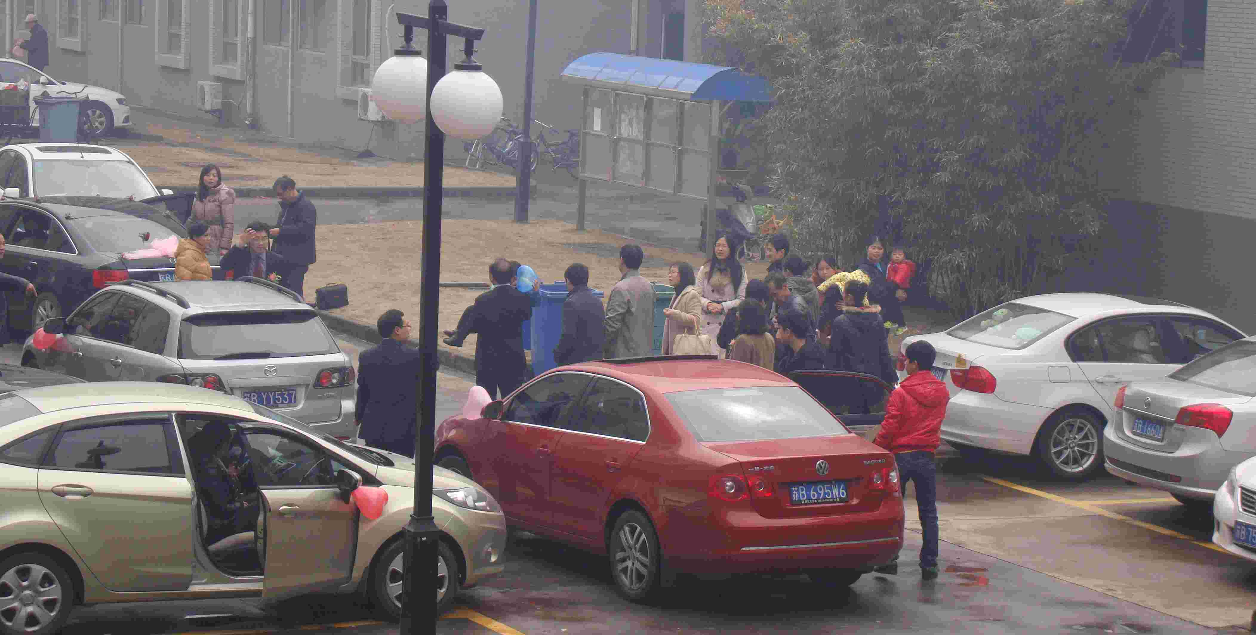Picture:  Early morning and the wedding party gathers outside our apartment building.  Jiangnan University, Wuxi, China