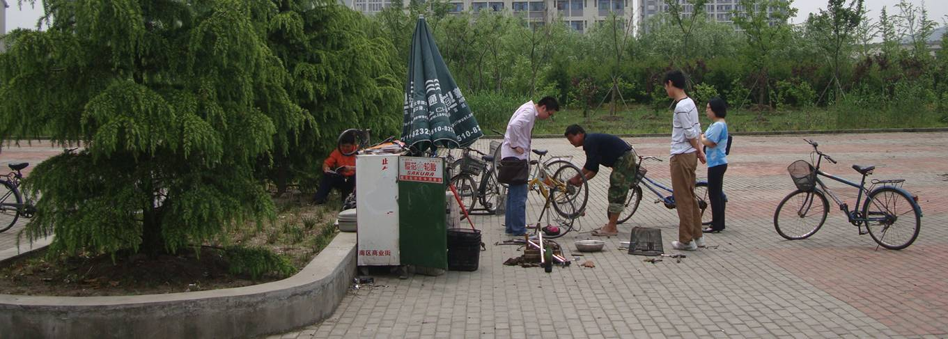 Bike repair across the road from our classrooms.  Low overhead.  Low cost.  Jiangnan University, Wuxi, China
