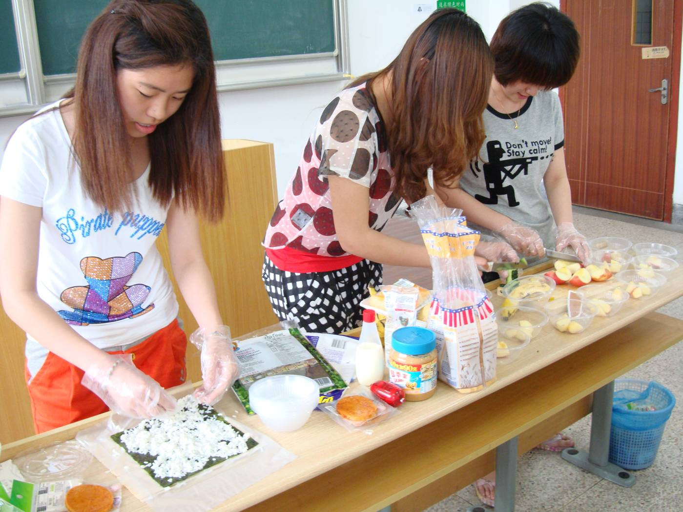 Picture:  Students prepare a fruit salad and sushi as a demonstration project.  North American College of Jiangnan University, Wuxi, China