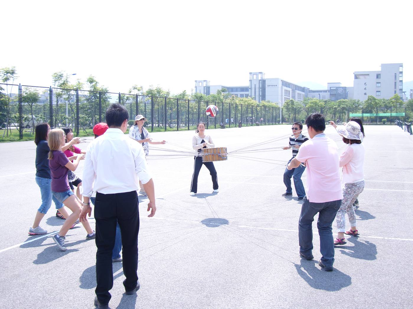 Picture:  A lively game of drum ball. Sports activity day at North American College of Jiangnan University.  Wuxi, China