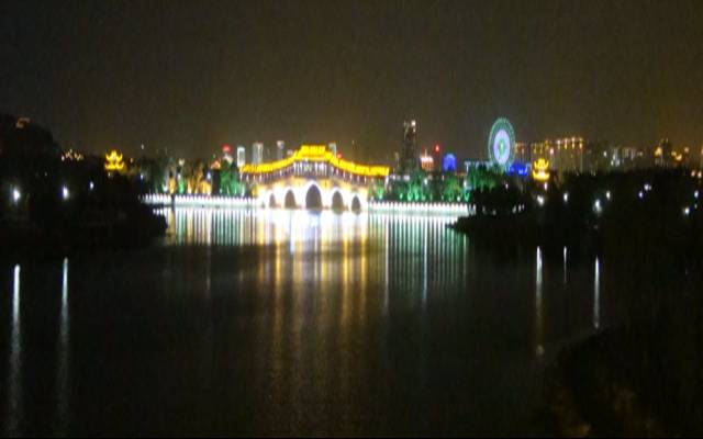 Picture:  The pedestrian bridge with the ferris wheel a mile or two in the background, reflected in the waters of Tai Hu.  Wuxi, China