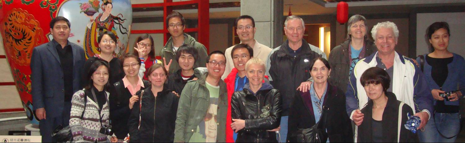 Picture: A group picture taken at the Shaoxing yellow wine museum.  The tour included a tasting room.  Shaoxing, China