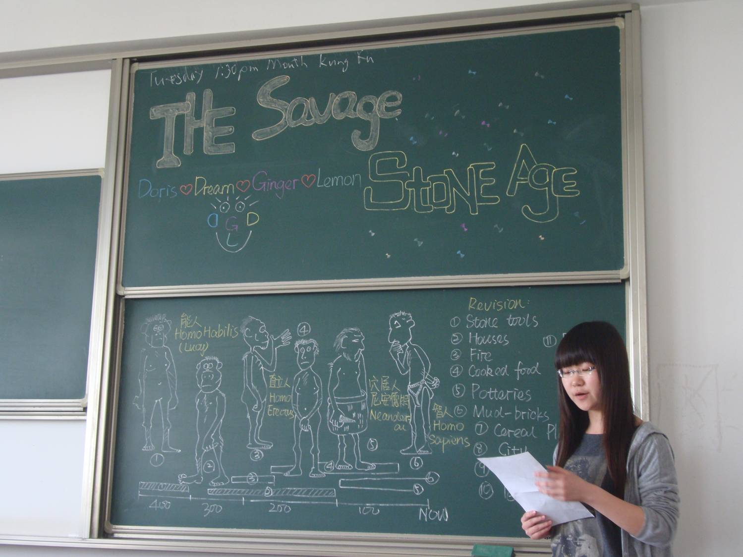 Picture:  A student does her part of a presentation on the stone age.  Jiangnan University, Wuxi, China