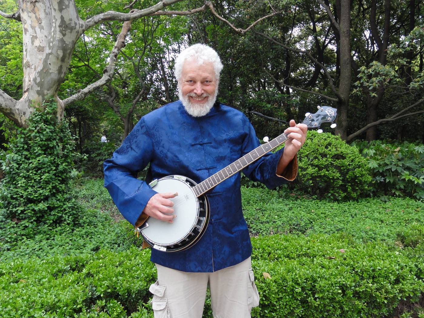 Picture:  Me and my new banjo.  People's Square Park in Shanghai is beautiful once you get away from the crowds.