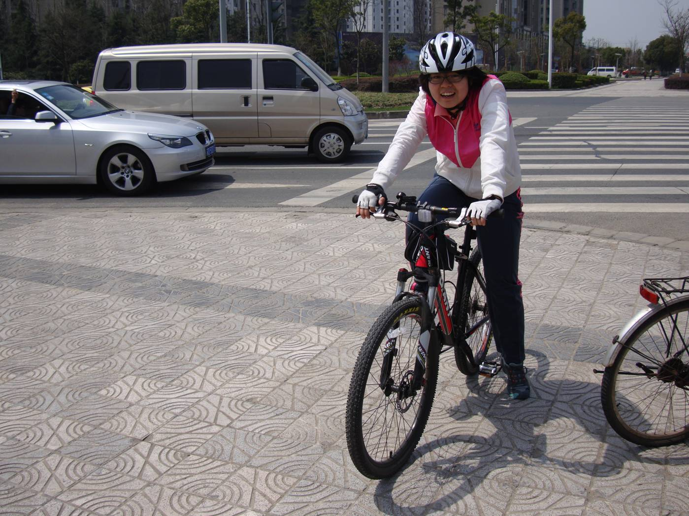 Picture:  Very rare to see a Chinese person wearing a bike helmet.  But this will change.  Wuxi, China